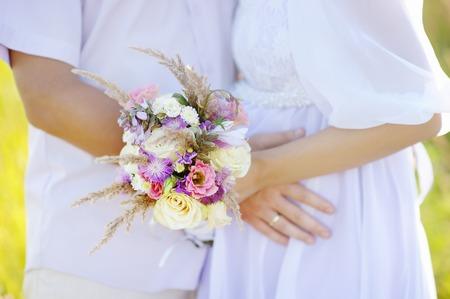 Woman holding wedding flowers bouquet photo