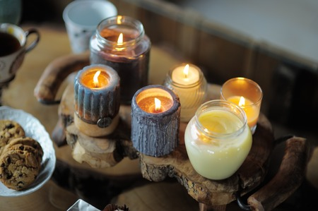 candle light dinner: Beautiful ablaze candle on the wooden table
