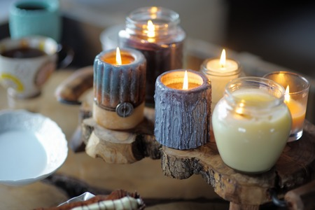 sconce: Beautiful ablaze candle on the wooden table