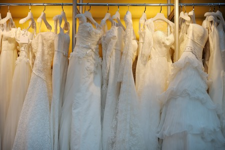 white dresses: A few beautiful wedding dresses on a hanger