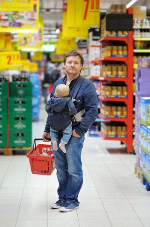 Father and his little son at supermarket photo