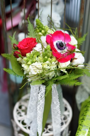 Bright flowers bouquet in vase at the flower shop photo
