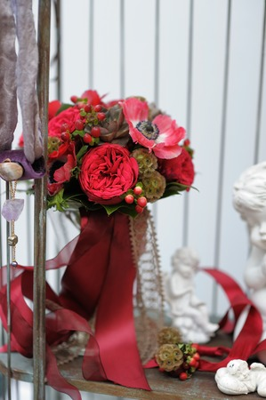 Red wedding bouquet and decoration objects in the flower shop photo
