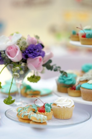 Delicious wedding sweet table with natural flowers photo