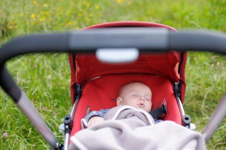 Sweet little baby boy sleeping in stroller 版權商用圖片