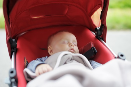 Sweet little baby boy sleeping in stroller Archivio Fotografico