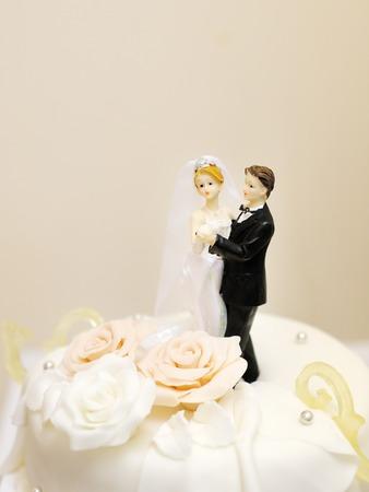 wedding cake: Figurines on top of wedding cake