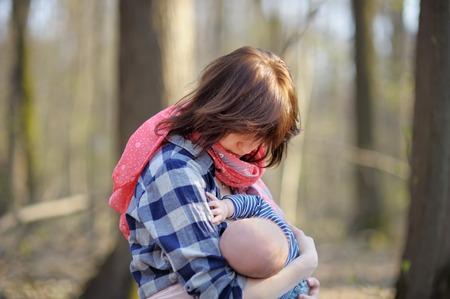 adult breastfeeding: Mother breastfeeding her baby