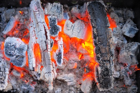 conflagrant: Background from a fire, conflagrant firewoods and coals Stock Photo