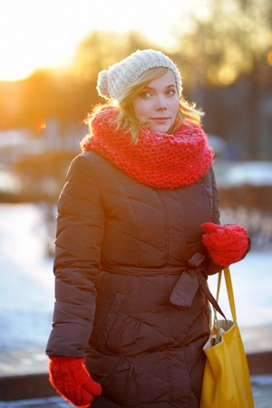 Outdoors portrait of young beautiful woman in the winter at sunset photo