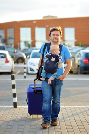 urban parenting: Active middle age father with his little son outdoors Stock Photo
