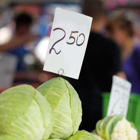 Fresh cabbages at the farmers market photo