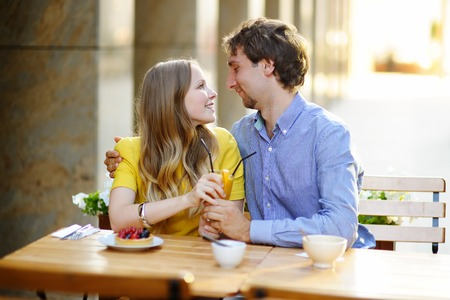 Young loving couple in outdoors cafe photo