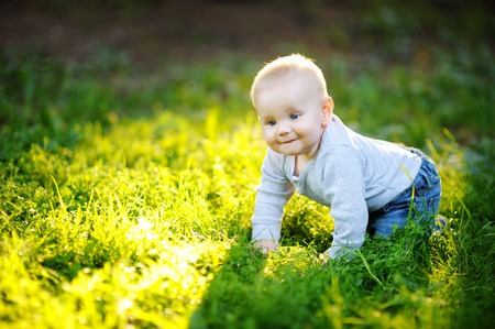 Portrait of little baby boy at the sunny park