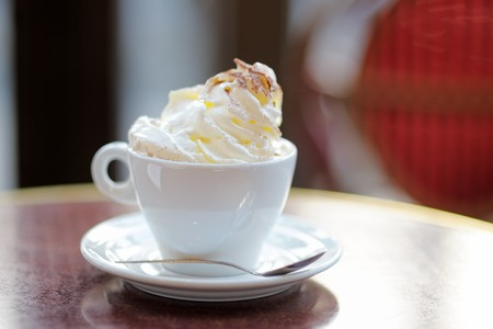 Cup of coffee or hot chocolate with whipped cream on the table at the cafe 版權商用圖片