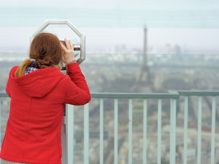 d'eiffel: Young beautiful woman on observation deck in Montparnasse building in Paris, France