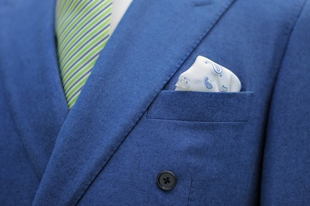 Blue suit with tie and handkerchief. Focused on handkerchief. photo