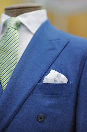 bespoke: Blue suit with tie, tie clip and handkerchief. Focused on handkerchief.
