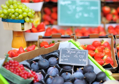 Sweet fresh bio figs and berry on Paris farmer agricultural market photo