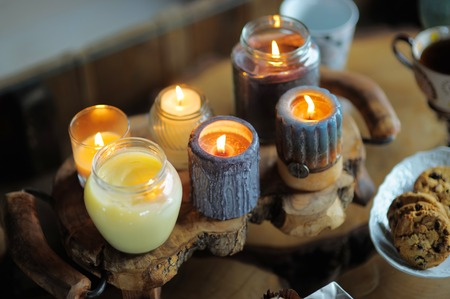 ablaze: Beautiful ablaze candle on the wooden table