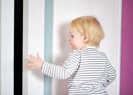 Blonde toddler boy playing at home photo