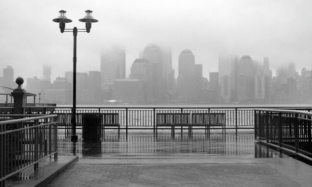 white view: Black and white photo of New York City skyline on a rainy day