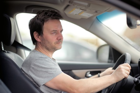 middle age man: Portrait of middle age man in a car Stock Photo