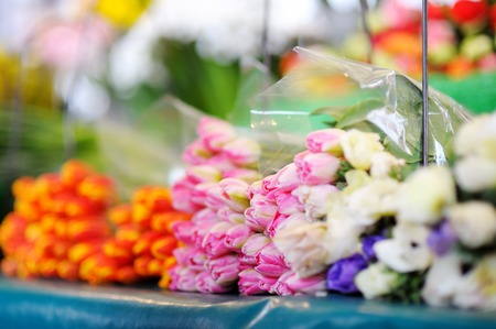 sidewalk sale: Beautiful cut flowers sold on outdoor flower shop in Paris, France Stock Photo
