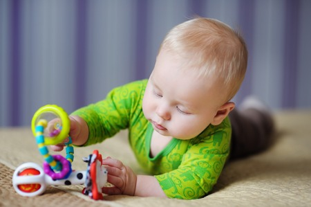 infant: Six month old baby play with bright toys