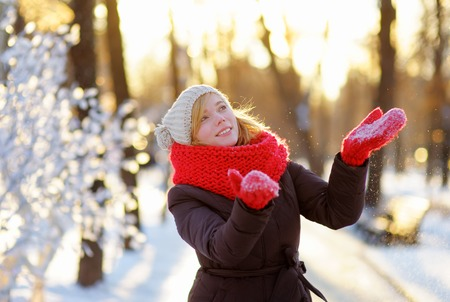 forest park: Outdoors portrait of young beautiful woman having fun in winter Stock Photo