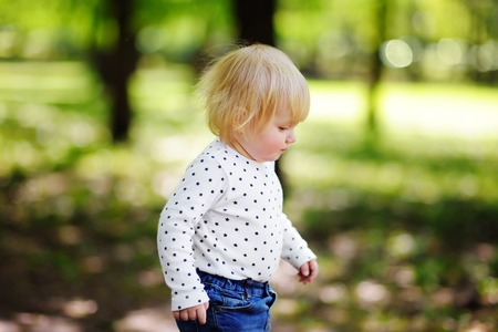 jungle boy: Outdoor portrait of toddler child at the sunny park