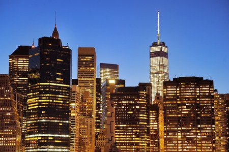 building trade: New York City Manhattan downtown skyline at night with illuminated skyscrapers Stock Photo