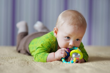 six month old: Six month old baby play with bright toy