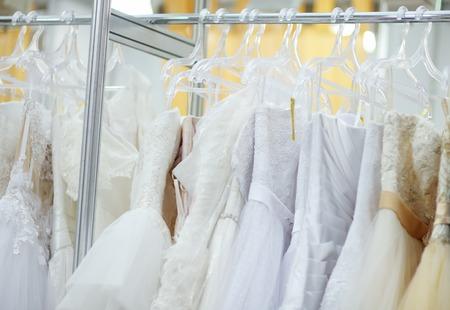 wedding dress: A few beautiful wedding dresses on a hanger