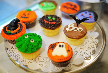 Dish of multicolor Halloween cupcakes