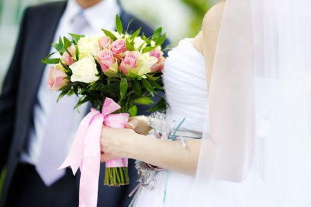 rose ring: Bride holding wedding flowers roses bouquet