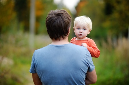 family portrait: Middle age father with his toddler son walking outdoors Stock Photo