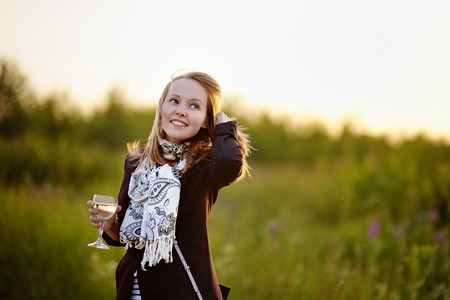 affectionate actions: Beautiful young girl with glass of white wine on a summer day Stock Photo