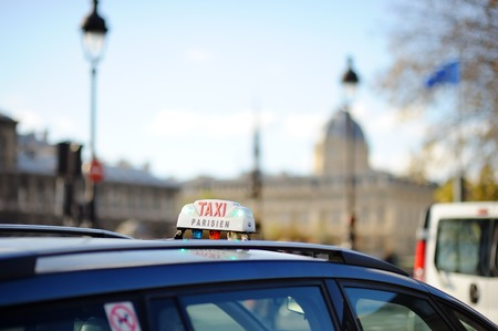 no rush: Taxi sign in Paris, France