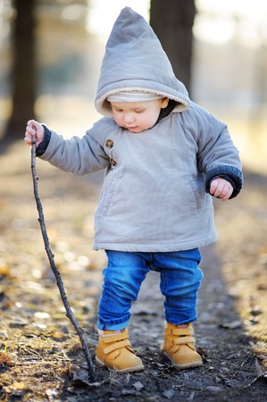 toddler boy: Beautiful toddler boy walking outdoors at the warm spring day