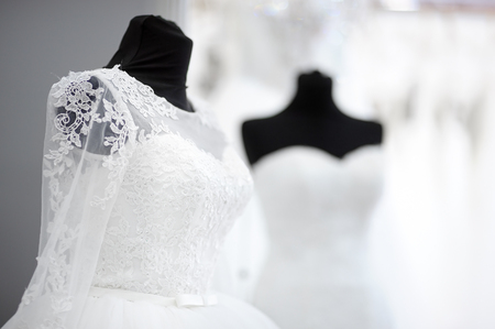 clothing store: Beautiful wedding dresses on a mannequin