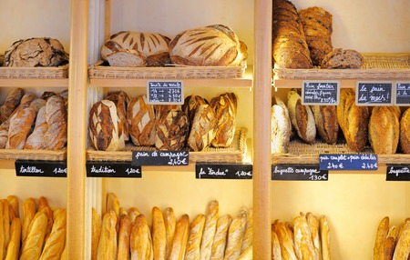 shop window: Freshly baked gourmet breads for sale in French bakery