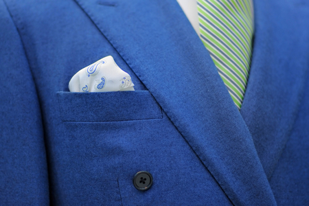 stylish men: Blue suit with tie and handkerchief. Focused on handkerchief. Stock Photo