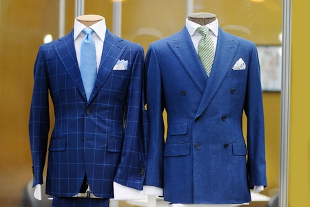 tailor suit: Beautiful blue suits with tie, tie clip and handkerchief on a mannequin Stock Photo