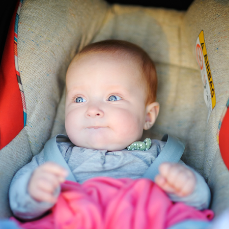 seat: Portrait of sweet baby girl in car seat