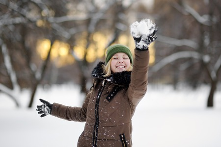 winter wood: Young beautiful woman having fun in winter park