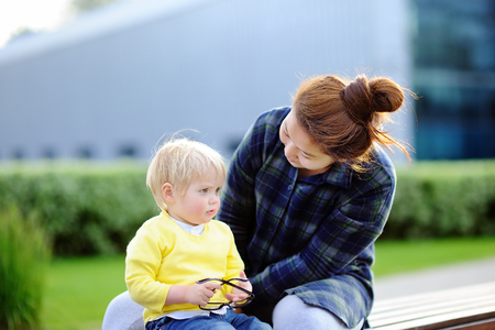 solicitous: Young loving asian woman with cute caucasian toddler boy. Babysitting concept Stock Photo