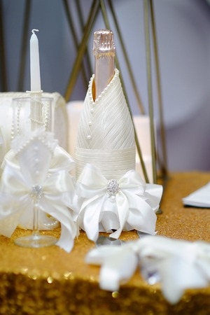 Bottle Of Champagne And Other Party Accessories On A Table For