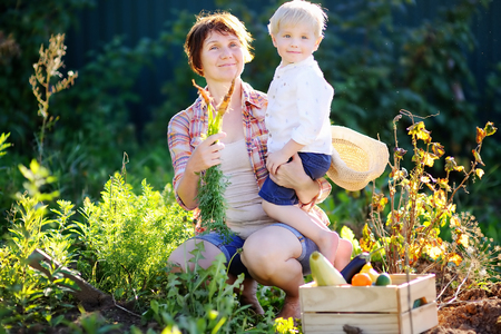 Beautiful middle aged women and her adorable little grandson enjoying harvest photo