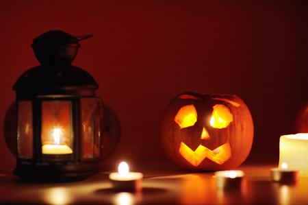 Three Halloween pumpkins head jack-o-lantern with colorful lights on background. Halloween concept